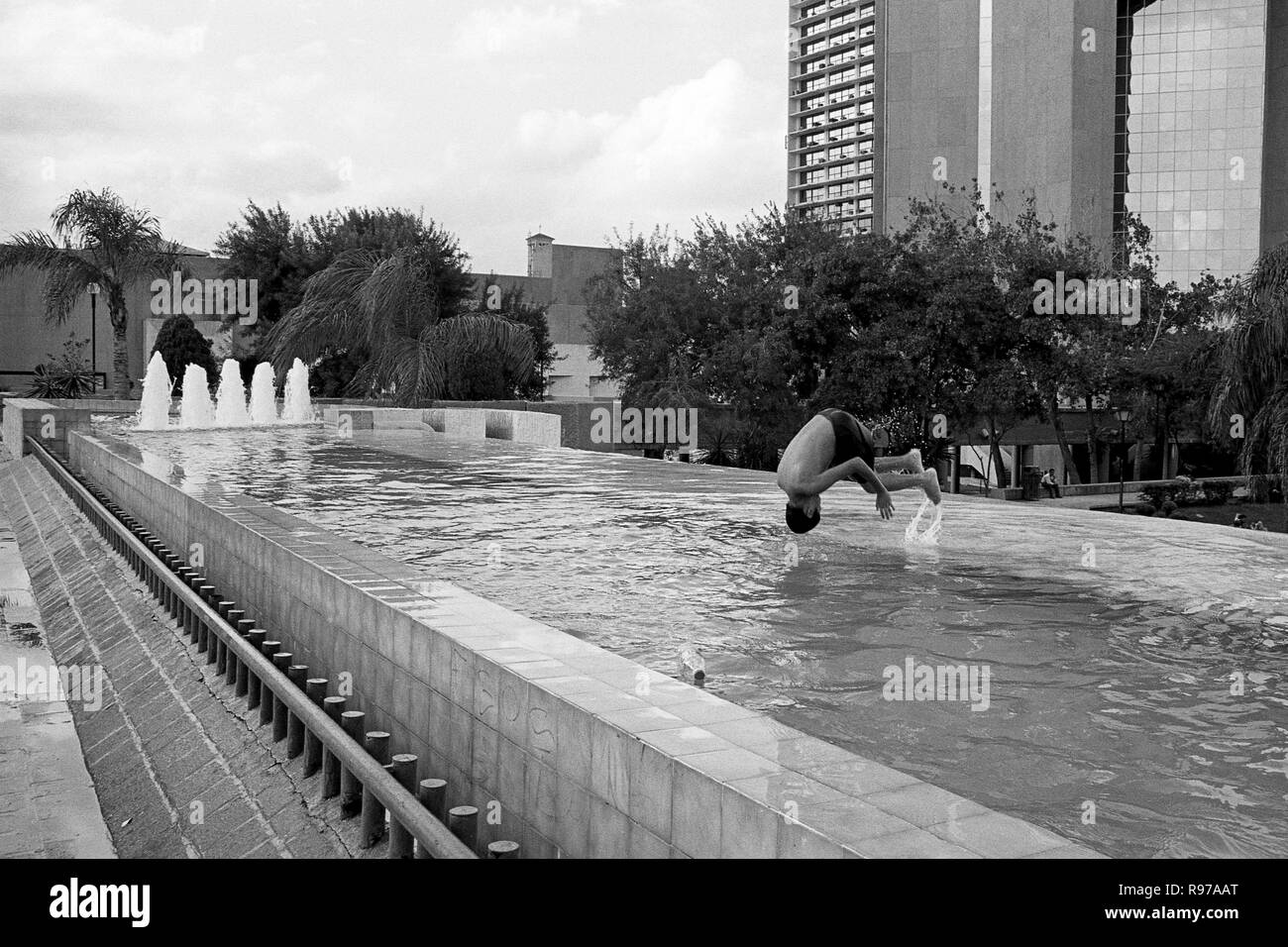 MONTERREY, NL/MEXICO - NOV 2, 2003: A boy takes a dip at a public fountain at the Macroplaza, to escape from the heat - Stock Image