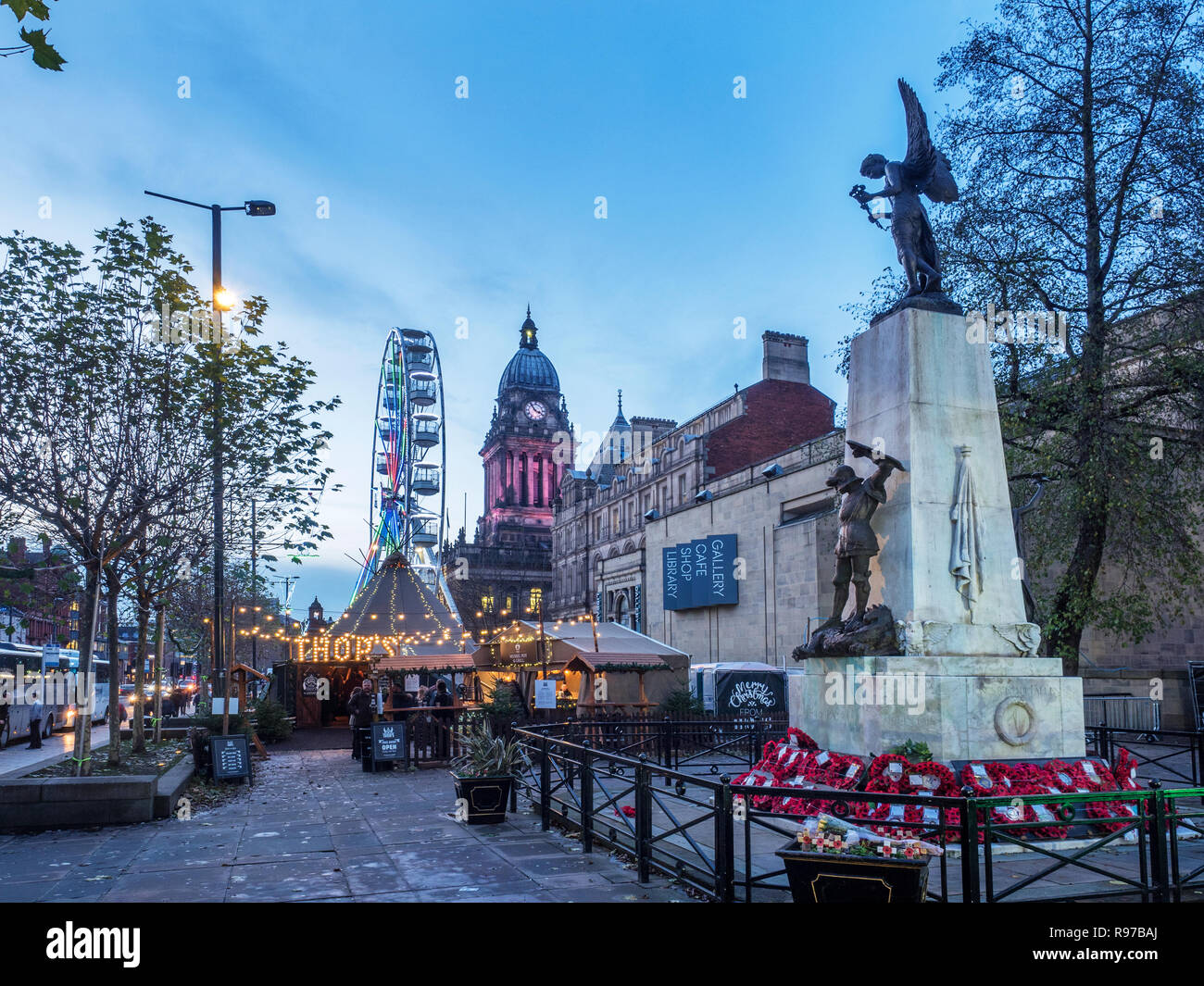 View along The Headrow from the War memorial to the Town Hall at Christmas Leeds West Yorkshire England - Stock Image