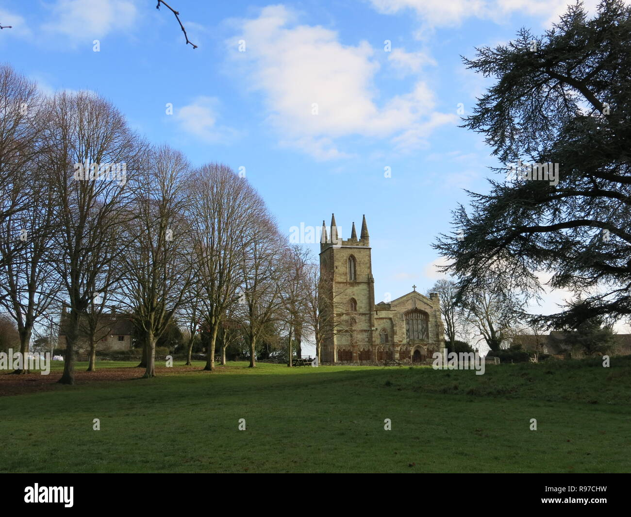 View of the Priory Church of St Mary, Canons Ashby, on a bright winter's day; December 2018 - Stock Image