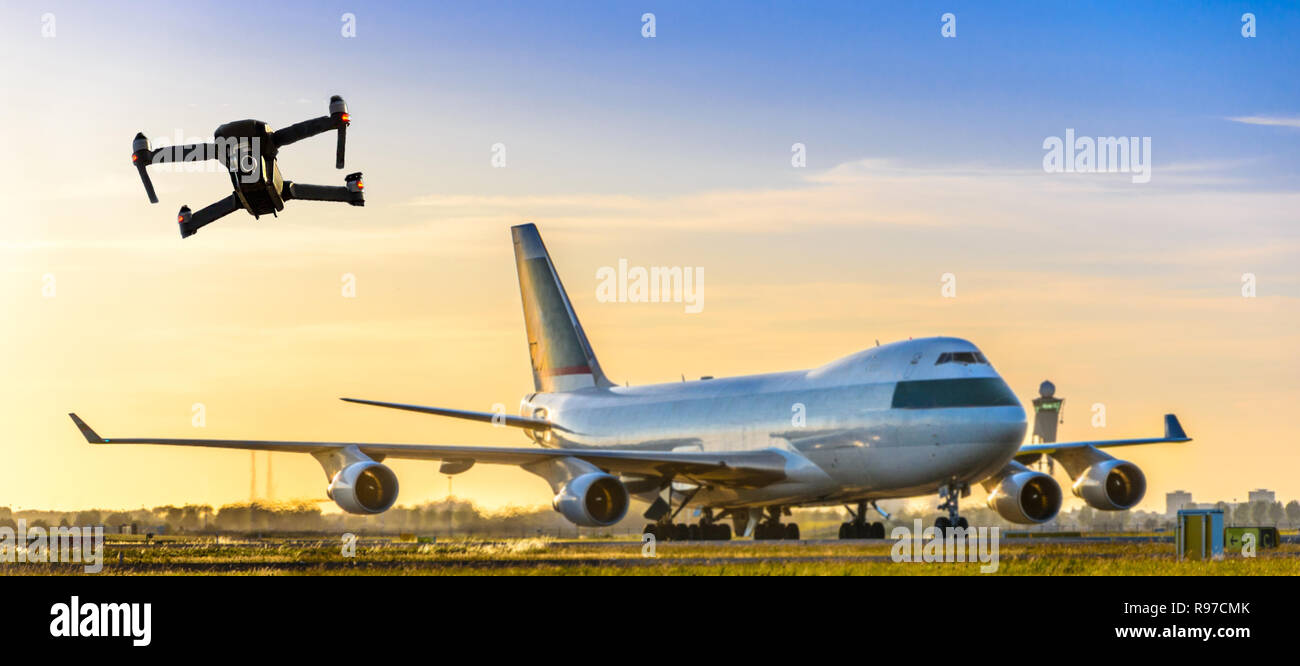 Unmanned drone flying near large commercial airplane at airport, flight disruption concept - digital composite - Stock Image