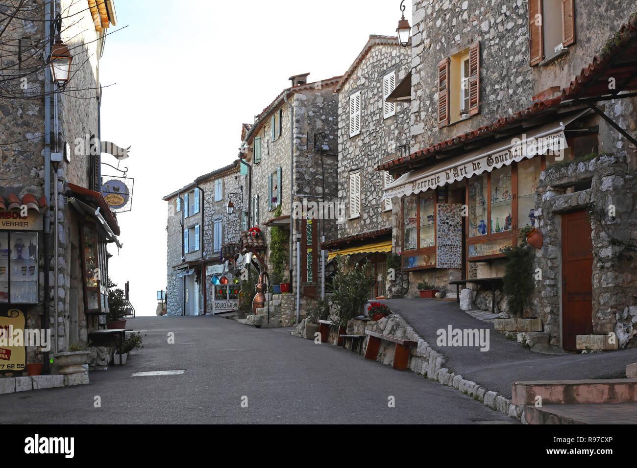 GOURDON, FRANCE - JANUARY 20: Main street in Gourdon on JANUARY 20, 2012. Main street with stone houses in Feudal style village Gourdon, France. - Stock Image