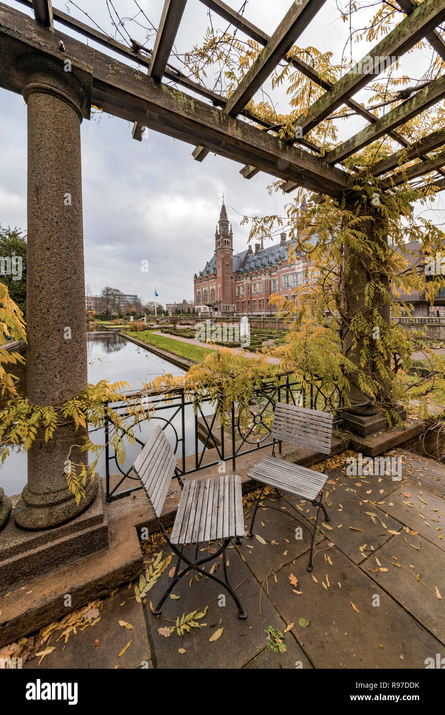 THE HAGUE, 3 December 2018 - Autumnal garden view of the Peace Palace, seat of the International Court of Justice in The Hague, Netherlandschair - Stock Image