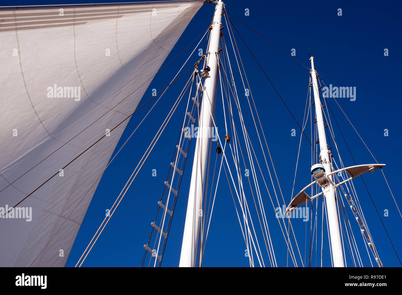 Bellingham Bay Marina with sailboats moored with blue sky and close-up of sails,masts and riggings - Stock Image