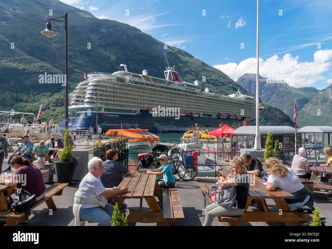 Quayside with Tui Mein Schiff 1 cruise ship in the background, Geiranger, Møre og Romsdal, Sunnmøre, Norway - Stock Image