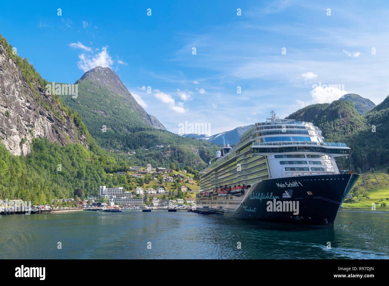 Tui Mein Schiff 1 cruise ship in the harbour at Geiranger, Møre og Romsdal, Sunnmøre, Norway - Stock Image