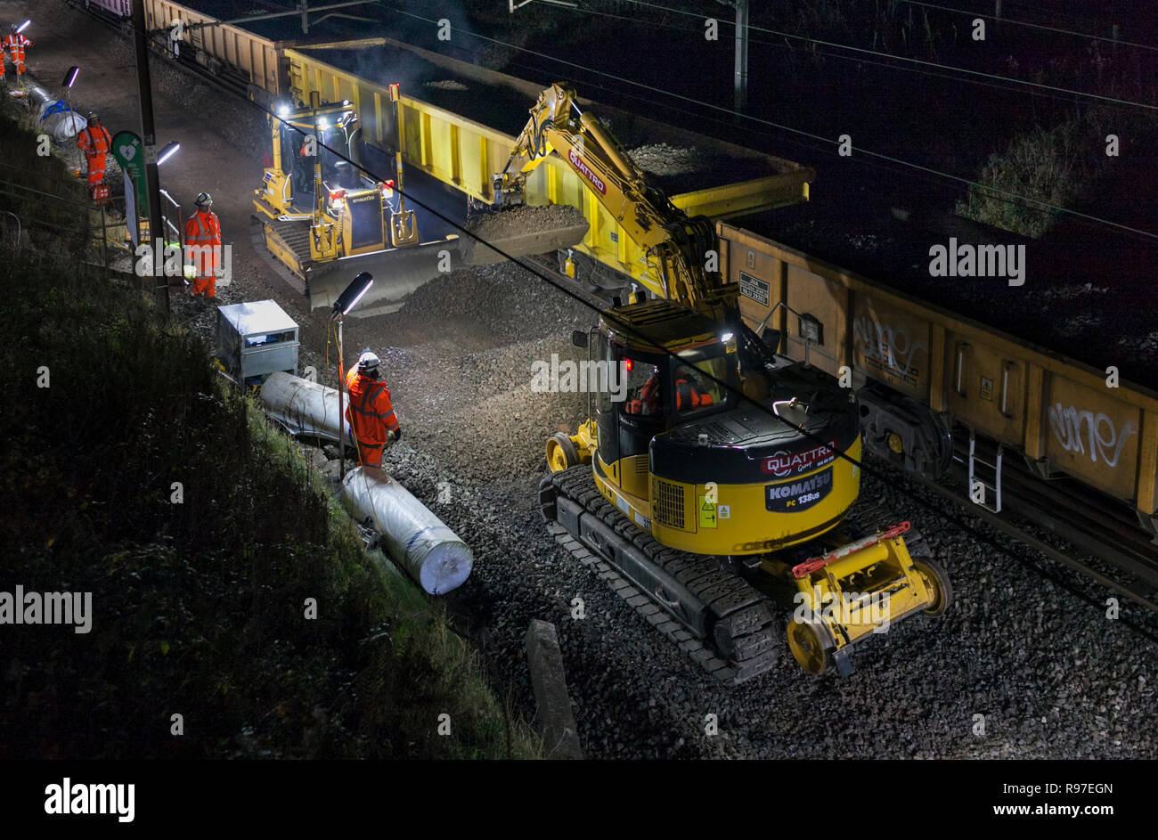 Network Rail track renewal under way during a night time possession on the West coast main line at Brock (north of Preston) contractor; Amey - Stock Image