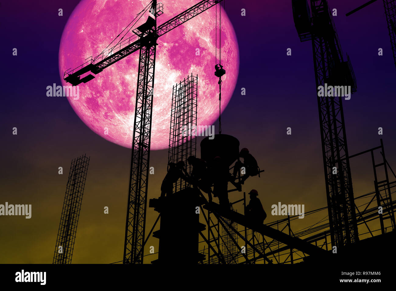 full pink moon back silhouette worker on construction building, Elements of this image furnished by NASA - Stock Image