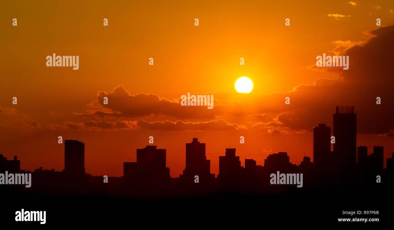 Silhouette City Sunset in Johannesburg South Africa with dramatic red and ornage sky - Stock Image