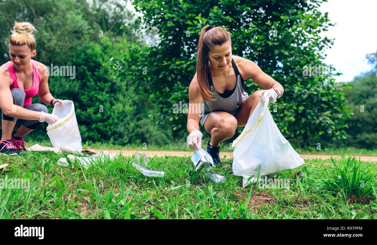 Girl with garbage bag doing plogging - Stock Image