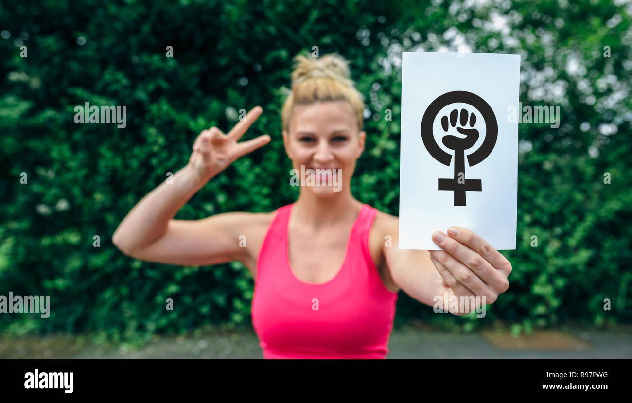 Woman showing symbol of feminism - Stock Image