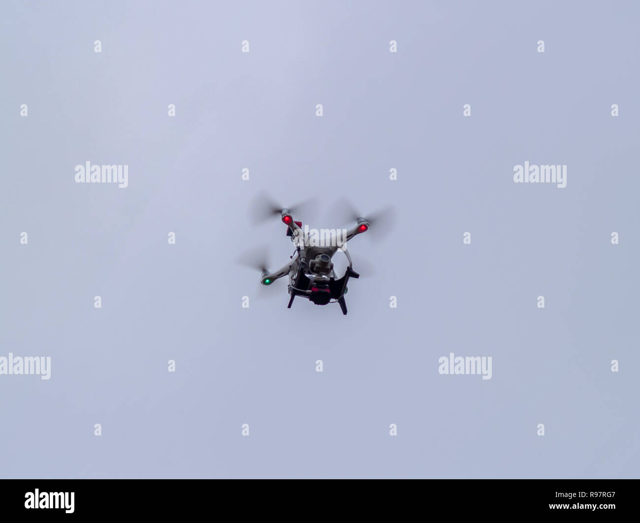 A drone in motion flying in the cloudy sky Stock Photo