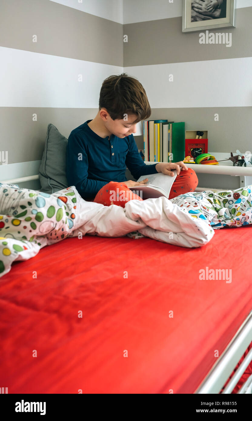Boy reading a book - Stock Image