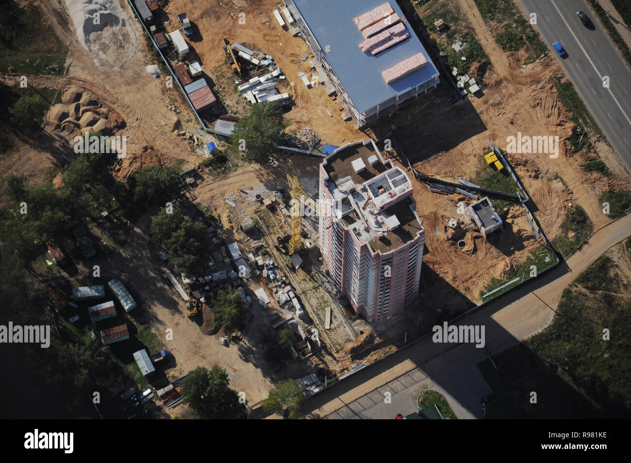 Kovrov, Russia. 17 August 2013. Kovrov town from the air. Stroiteley Street. Multi-story building is under construction - Stock Image