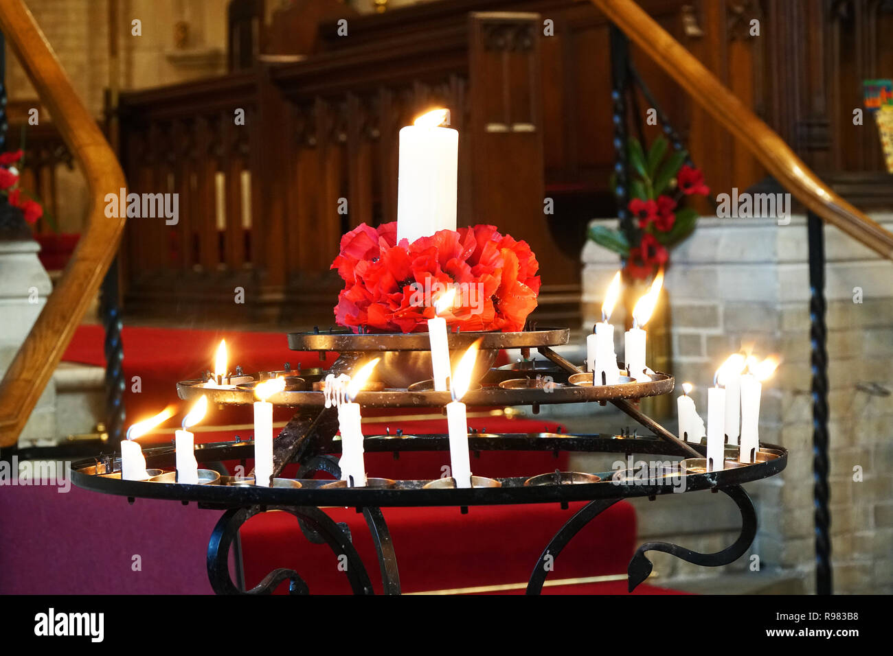 Memorial or voltive candles in a church for a service of remembrance - Stock Image