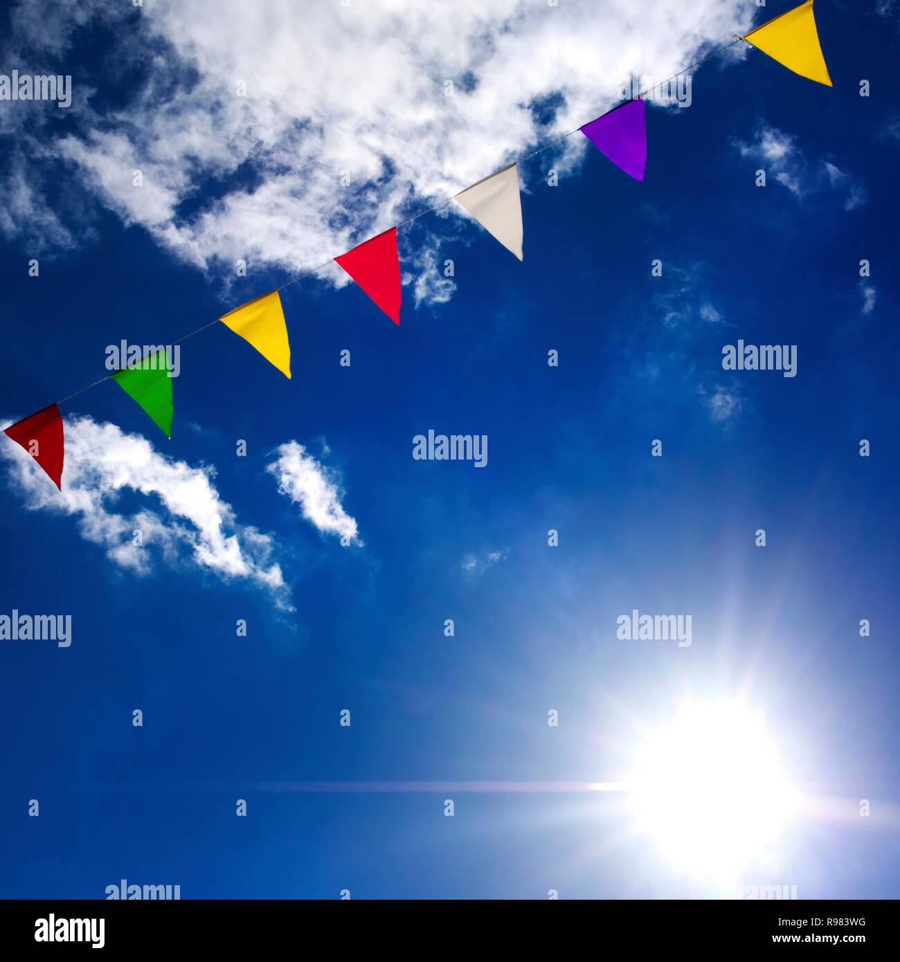 Multicolored pennants with blue sky, France - Stock Image