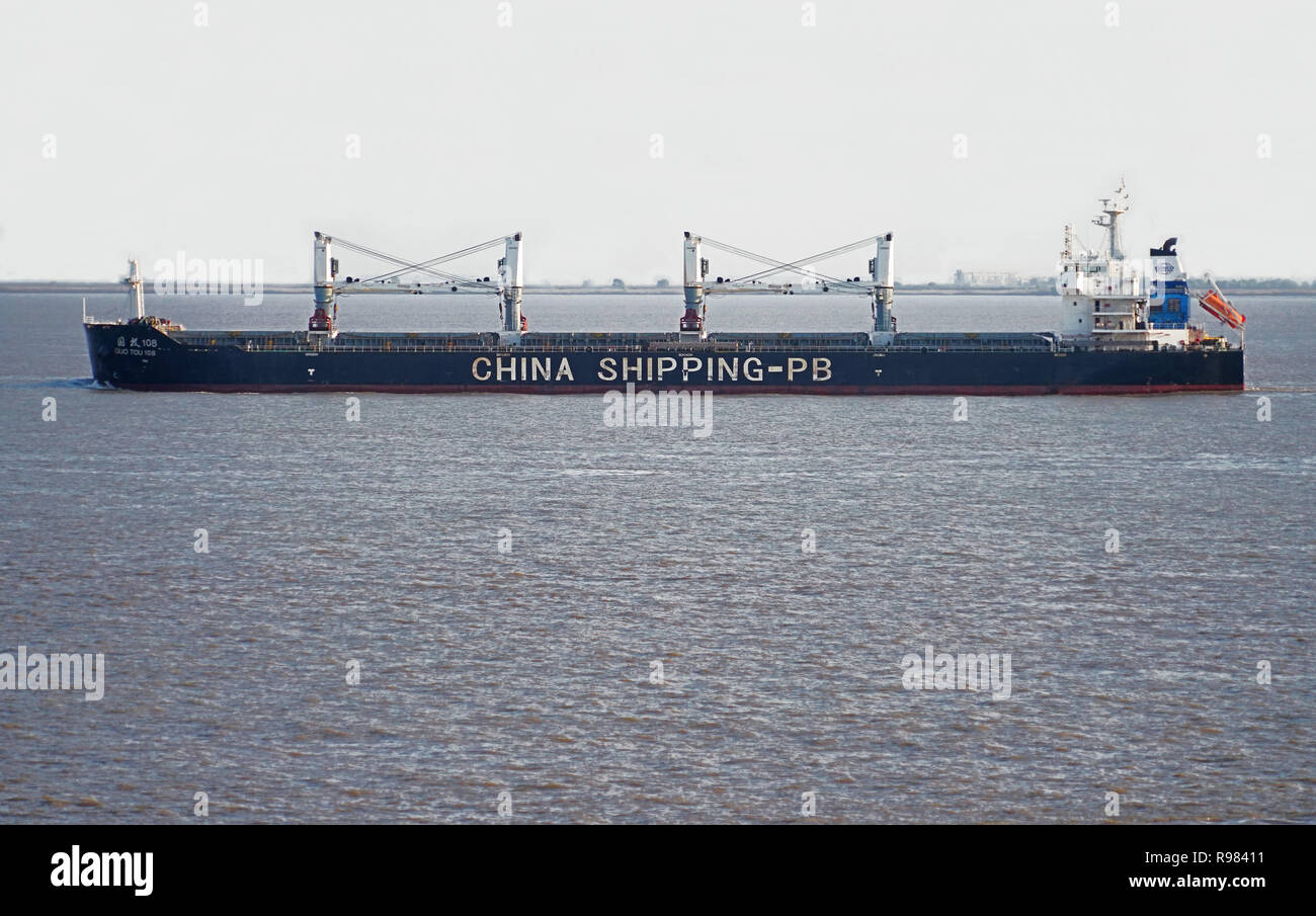Chinese freighter in East China Sea leaving port of Shanghai - Stock Image