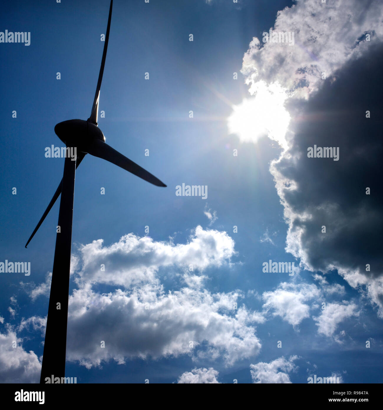 Wind turbine and cloudy sky , Puy de Dome, Auvergne, France, Europe - Stock Image