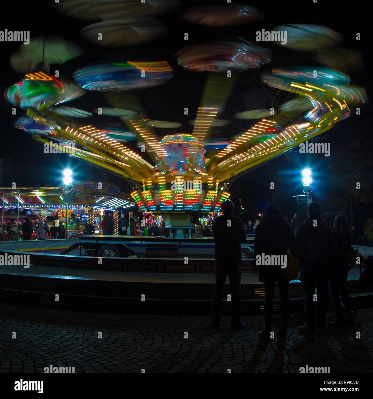 Gorizia, Italy - December 02, 2018: Annual traditional Christmas fair in center of Gorizia city, Italy. Ferris wheel on the background. - Stock Image