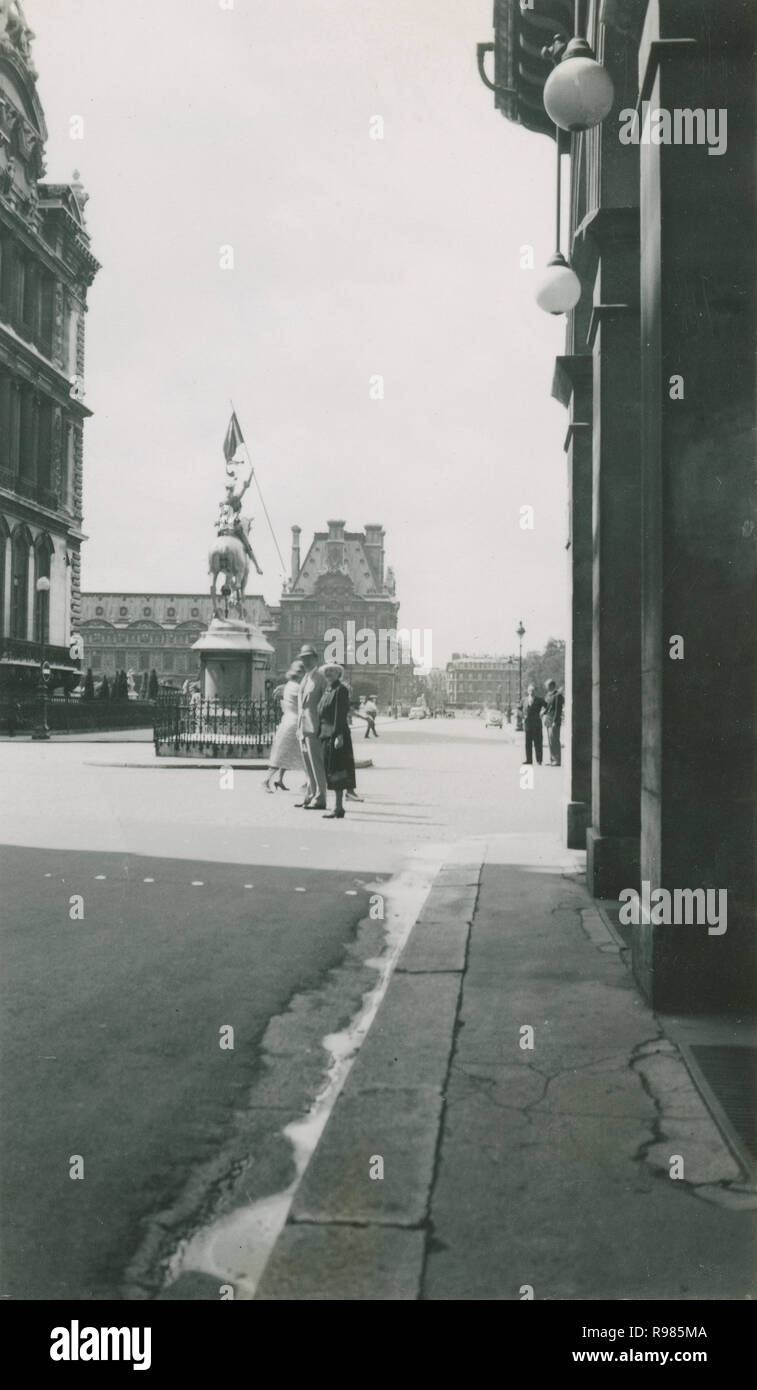 Antique c1930 photograph, tourists near the statue of Joan of Arc in Place des Pyramides in the 1st arrondissement of Paris, France. SOURCE: ORIGINAL PHOTOGRAPH - Stock Image