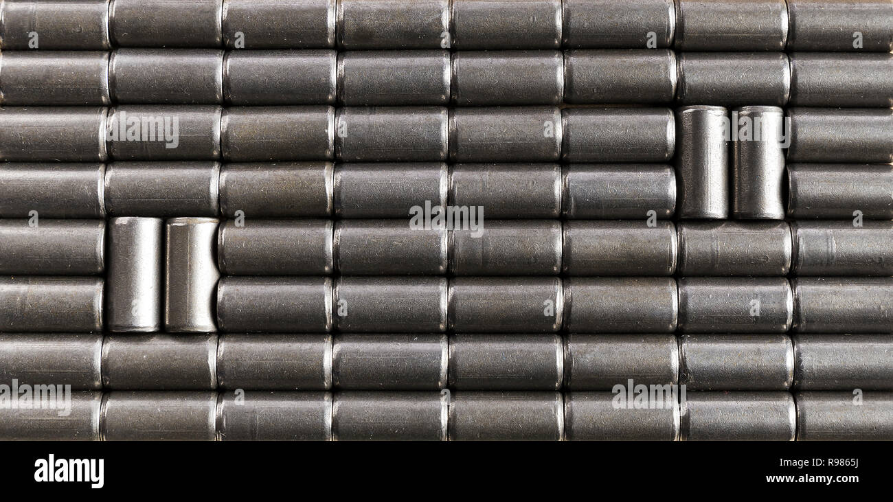 Gray background of small iron cylindrical pieces to use in advertising as a background - Stock Image