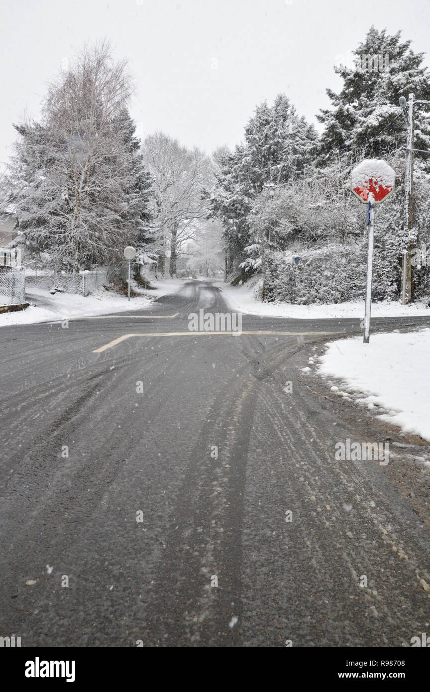 A slippery and dangerous road with a crossroad - Stock Image