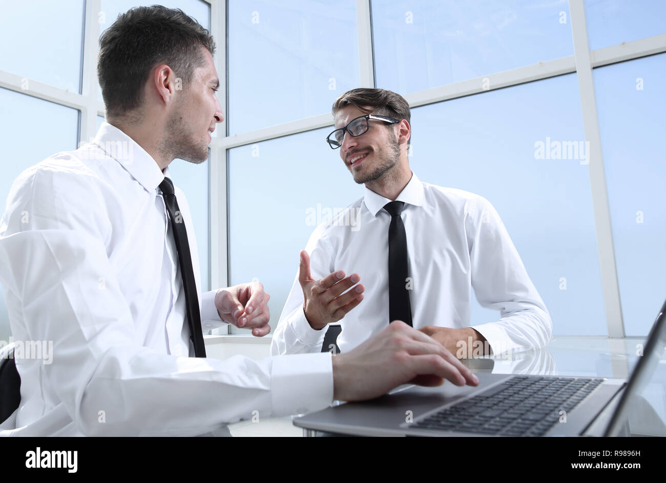 Business team discussing together plans - Stock Image