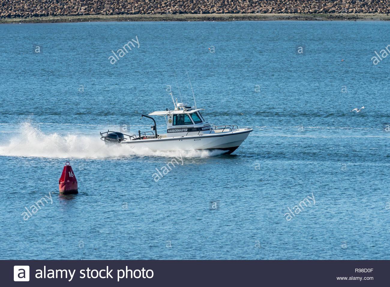 Fairhaven, Massachusetts, USA - November 4, 2018: Fairhaven Harbormaster's patrol boat returning from outer harbor - Stock Image