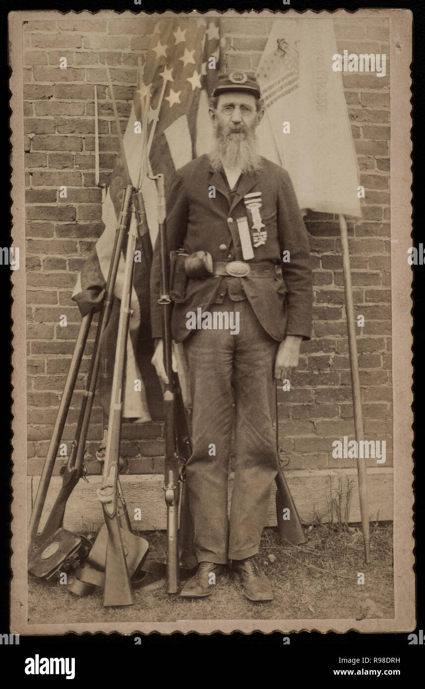 Unidentified Civil War Veteran from Grand Army of the Republic, Portrait in Uniform with Musket, 1880's - Stock Image