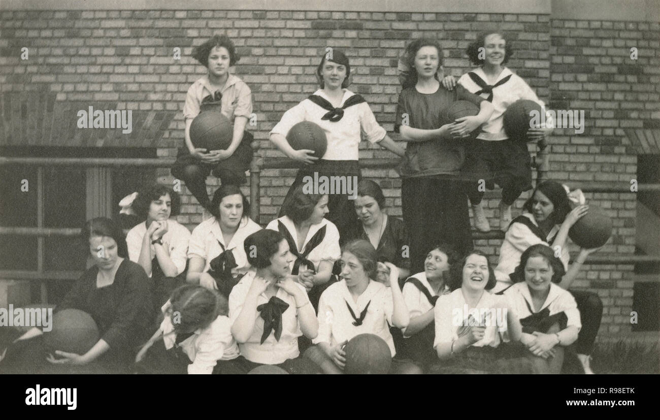 Antique c1915 photograph, school girls with medicine balls. SOURCE: ORIGINAL PHOTOGRAPH - Stock Image