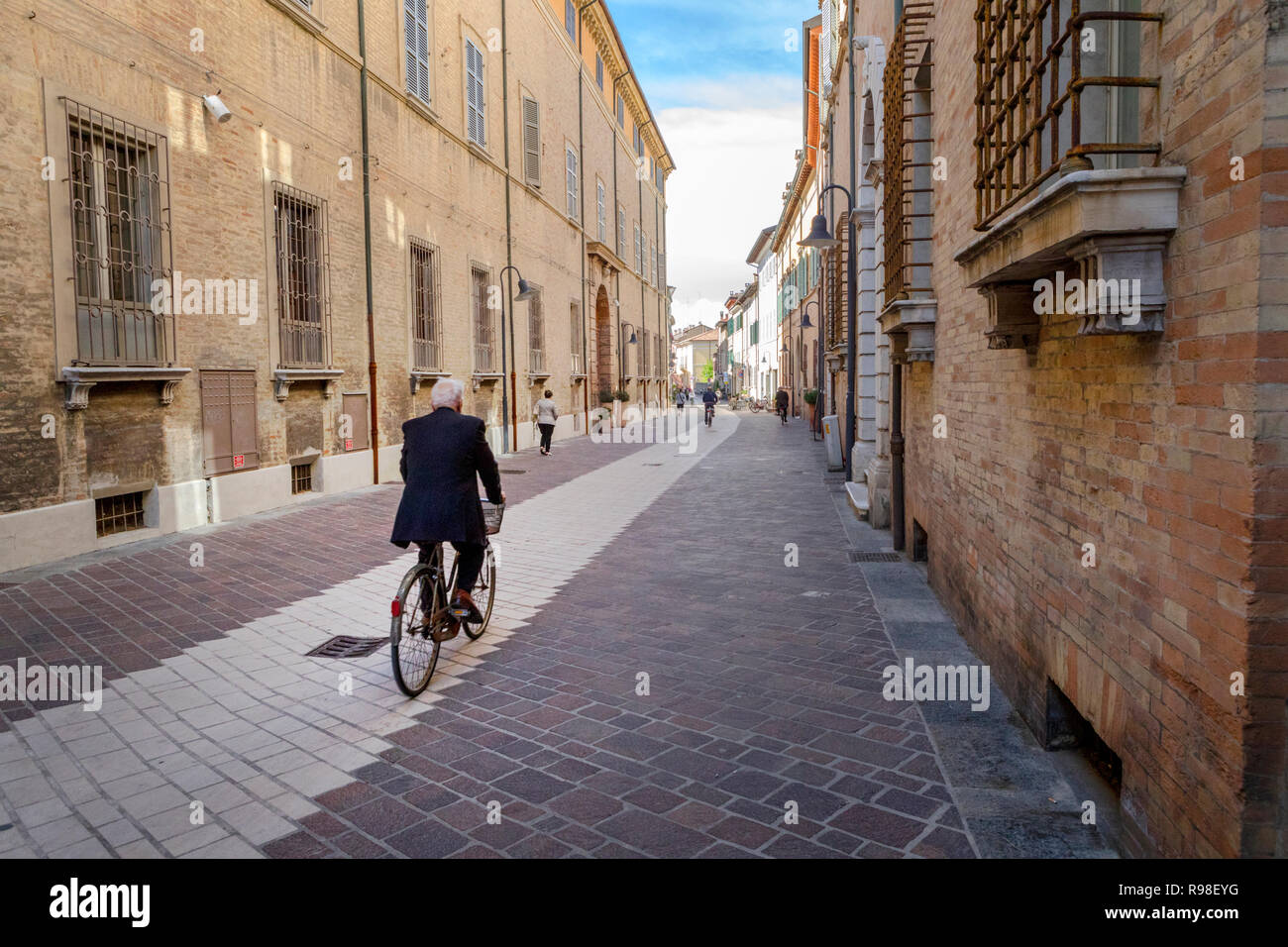 A cyclist in Ravenna, Italy - Stock Image