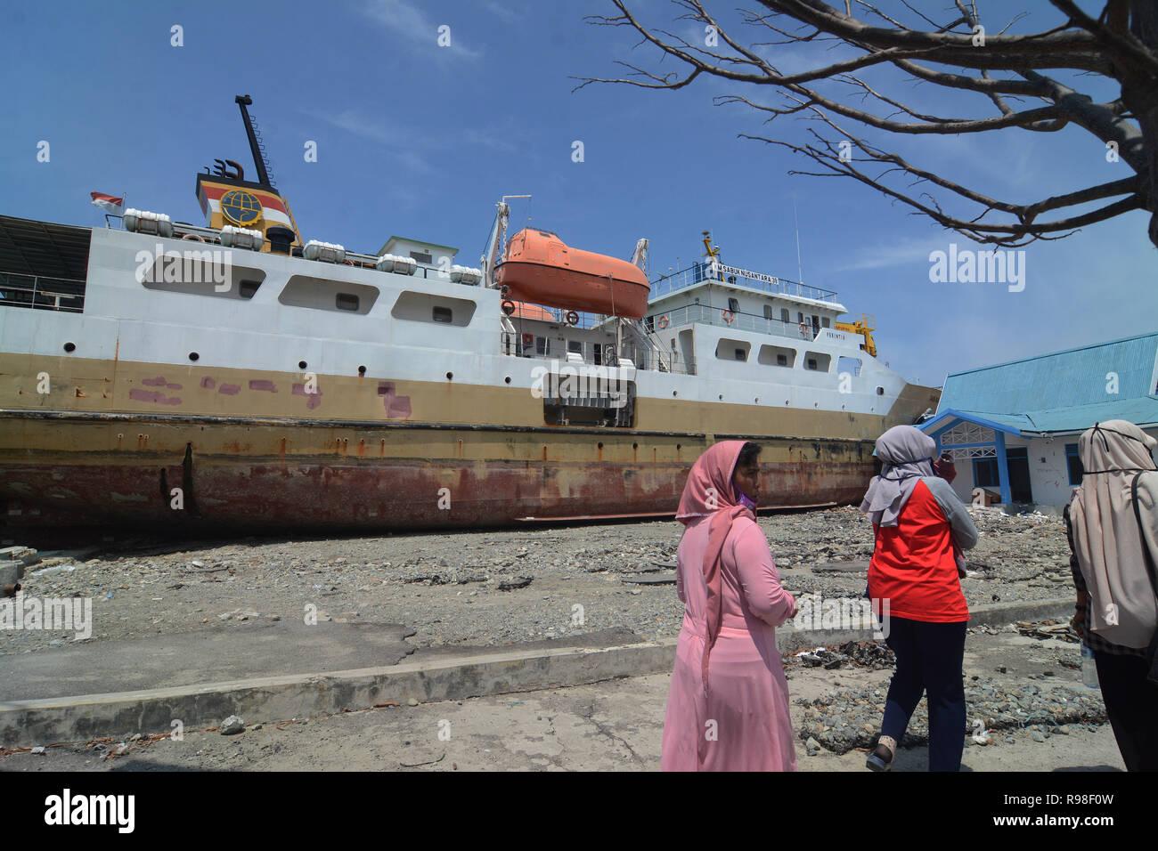 Residents move near KM Sabuk Nusantara which crashed ashore due to the tsunami in Wani, Donggala, Central Sulawesi, Saturday (November 3, 2018). - Stock Image
