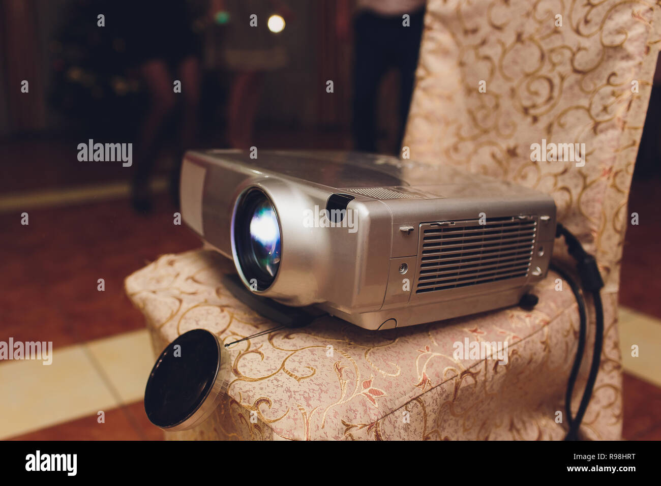 Closeup of projector for presentation in blue light tone. - Stock Image