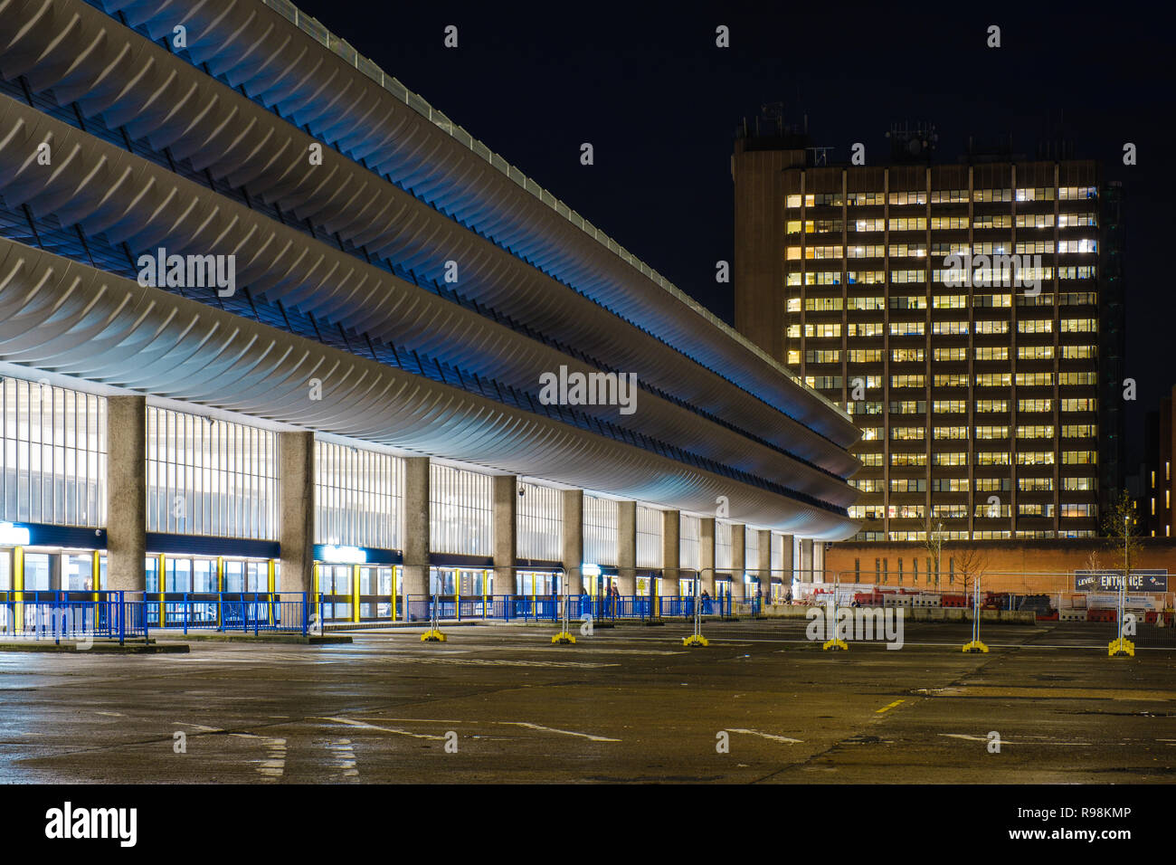 Preston's Brutalist Bus Station at night with no buses on the side that is no longer used by them. - Stock Image