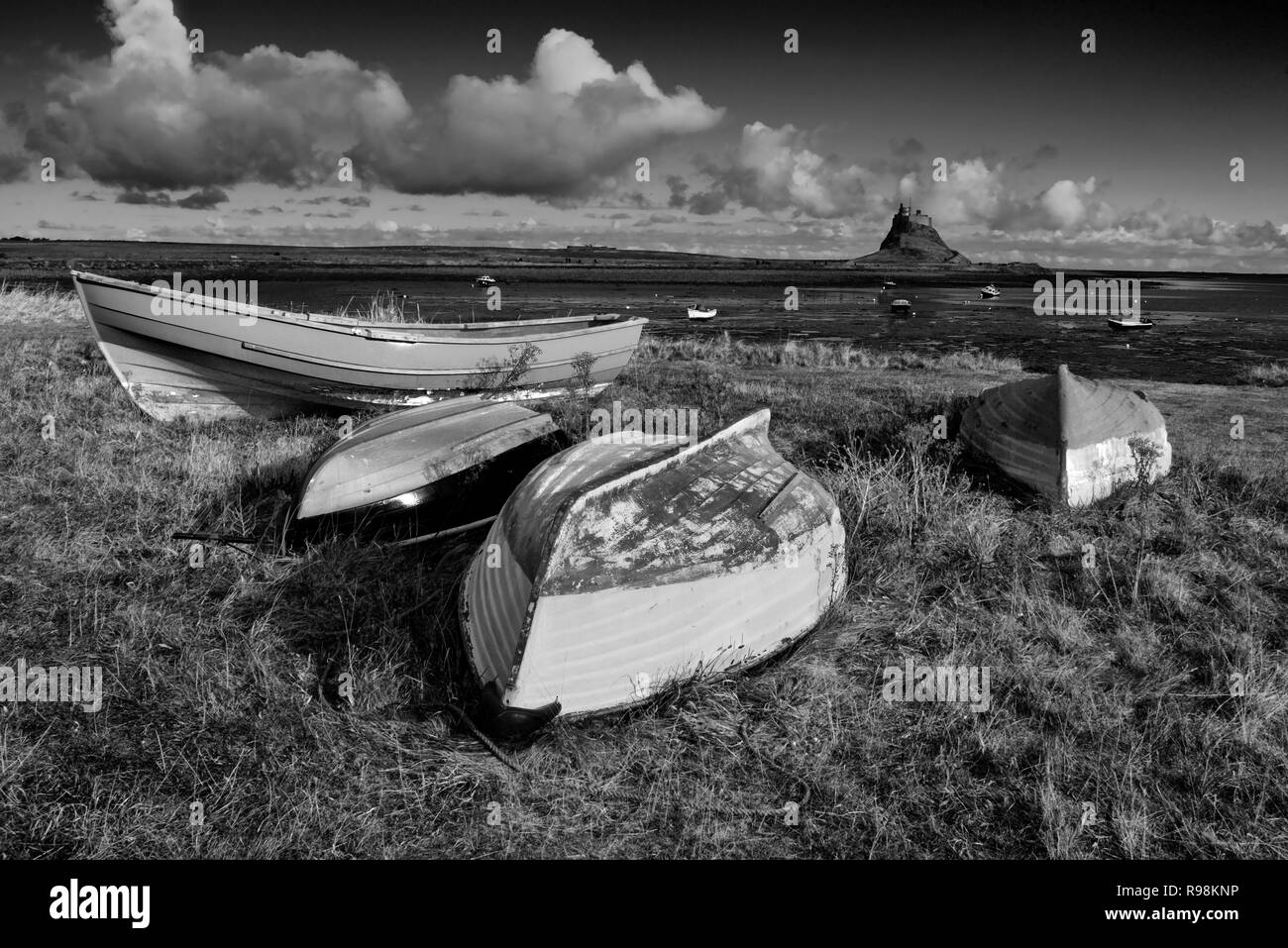 Boats at Lindisfarne in mono Stock Photo