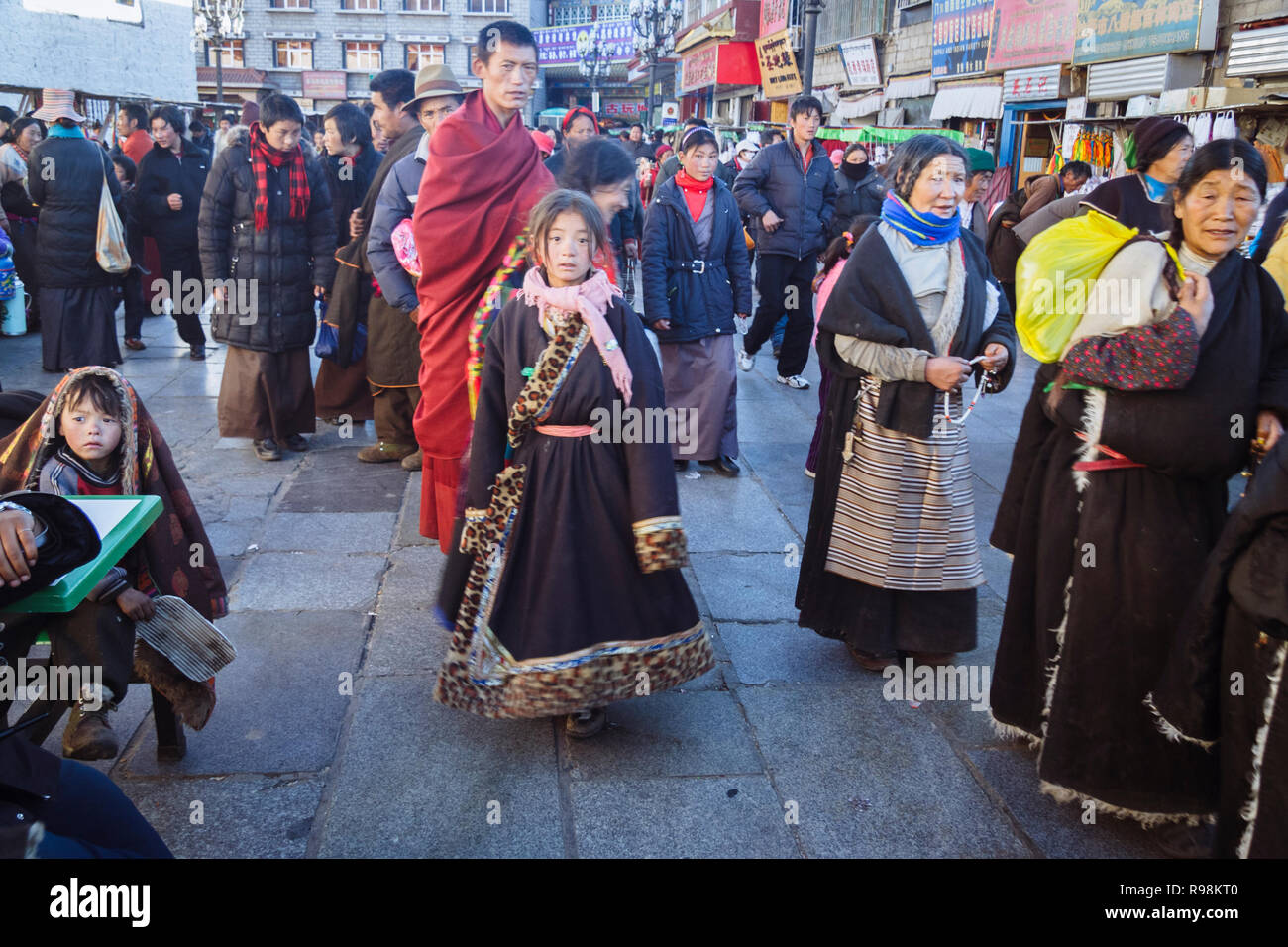 Lhasa, Tibet Autonomous Region, China : Tibetan people walk in the streets of the Barkhor district. - Stock Image