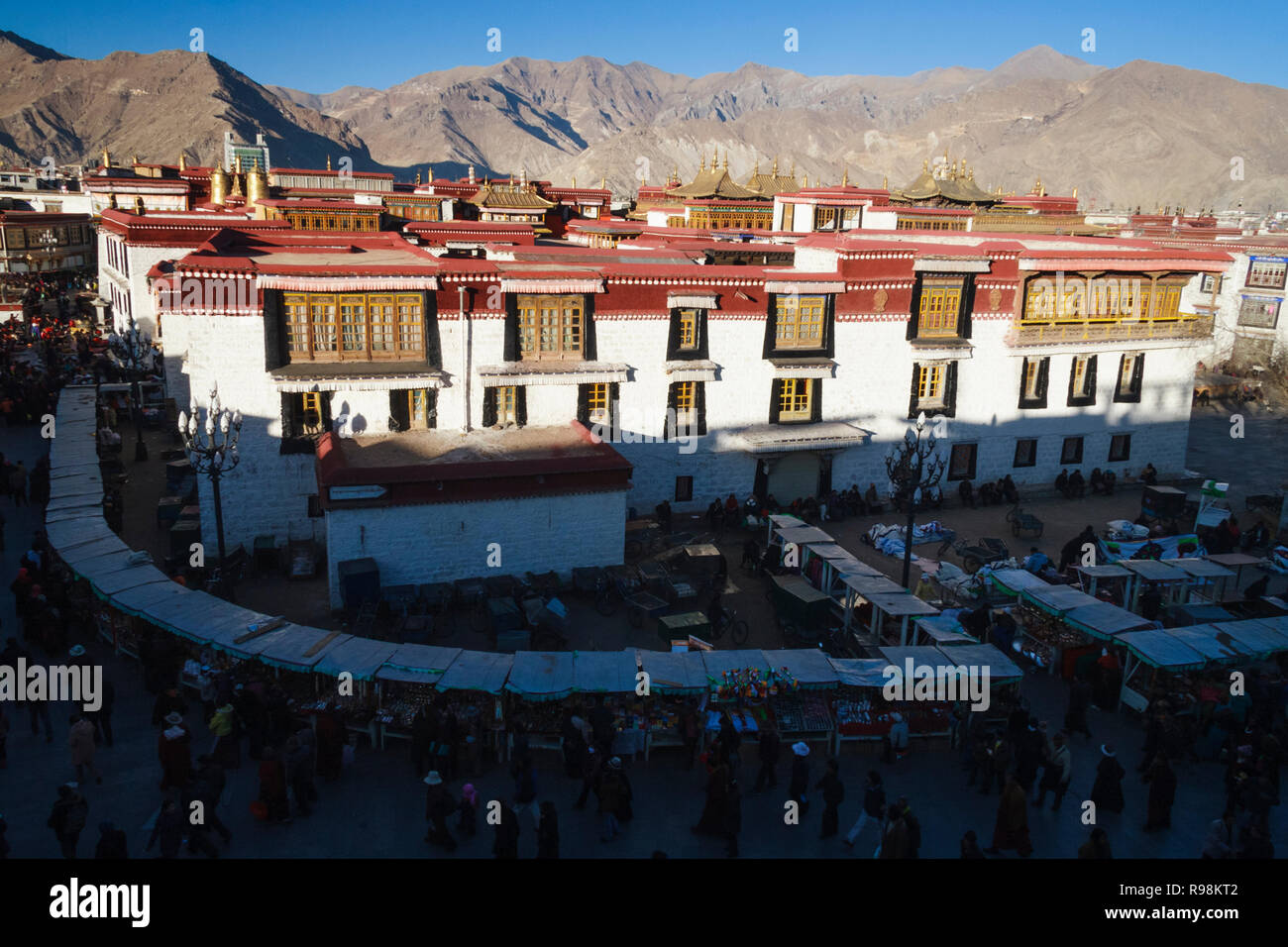 Lhasa, Tibet Autonomous Region, China : High angle view of Tibetan Buddhist pilgrims walking around the Jokhang temple in Barkhor Square. The Jokhang  - Stock Image