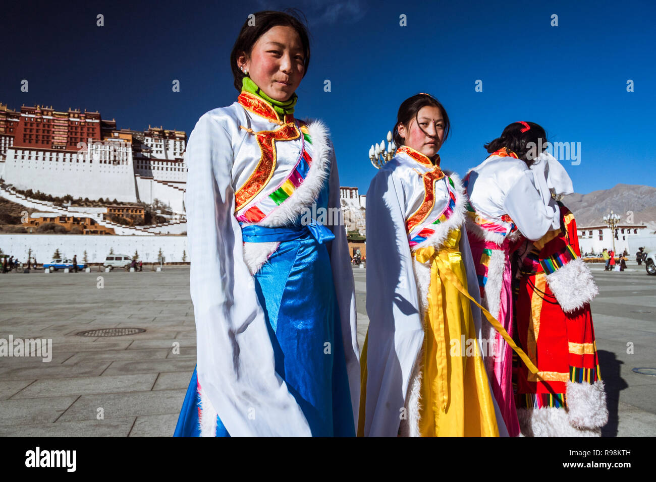 Lhasa, Tibet Autonomous Region, China : Young Tibetan women try out traditional costumes next to Potala palace. First built in 1645 by the 5th Dalai L - Stock Image