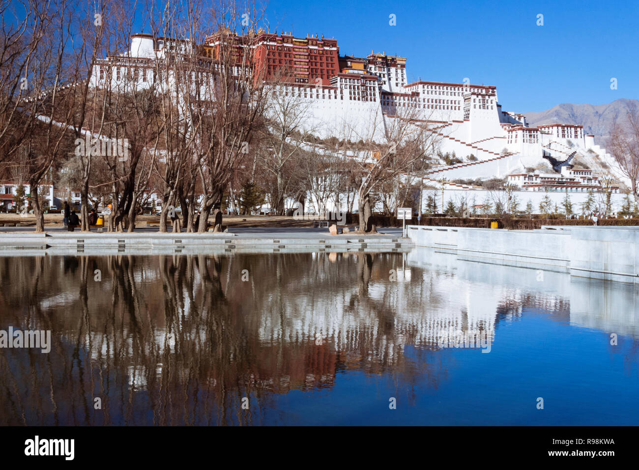 Lhasa, Tibet Autonomous Region, China : Potala palace reflected on a pool. First built in 1645 by the 5th Dalai Lama, the Potala was the residence of  - Stock Image