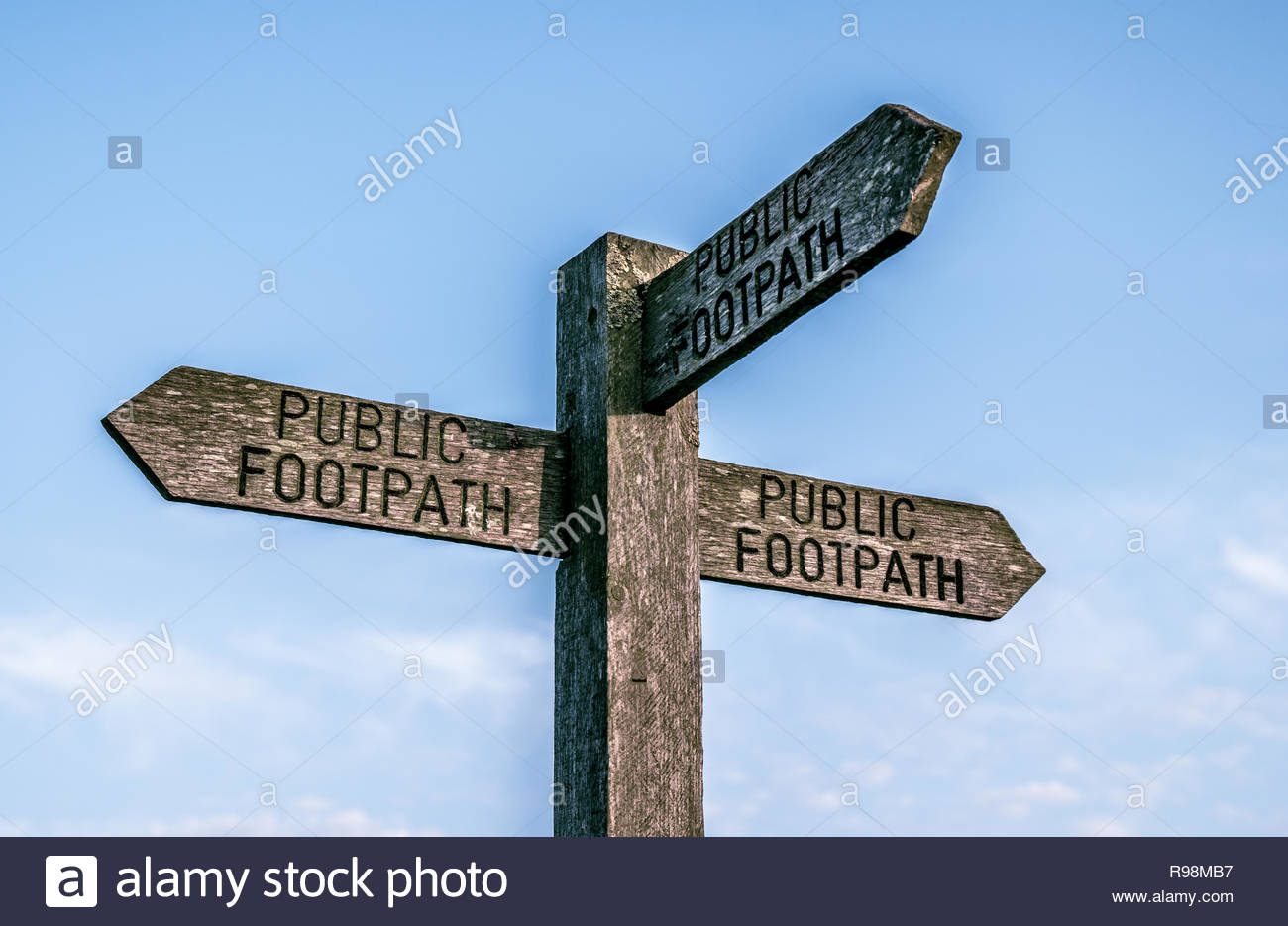 3 direction public footpath sign Stock Photo