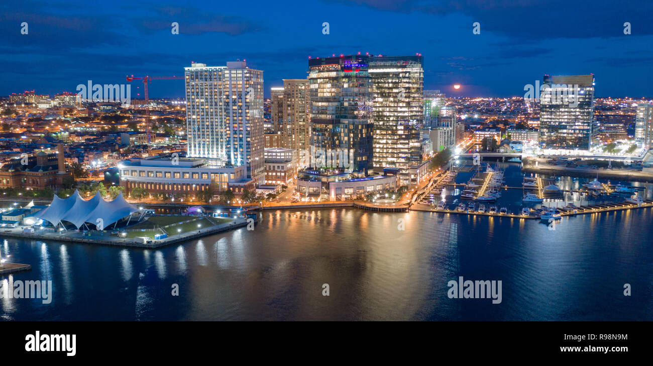 The buildings are illuminated in the downtown urban core of Baltimore Maryland - Stock Image