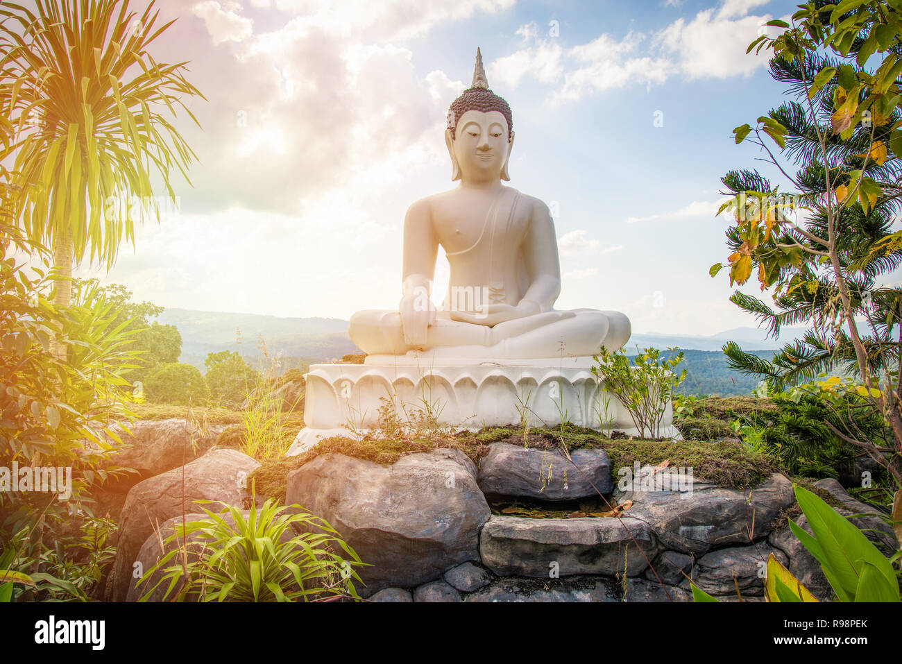 Garden Buddha Statue The Buddha Statue White On The Rock Hill Landscape Statue Buddha Sitting On Outdoor Bright Day With Tree And Sky Background Stock Photo Alamy