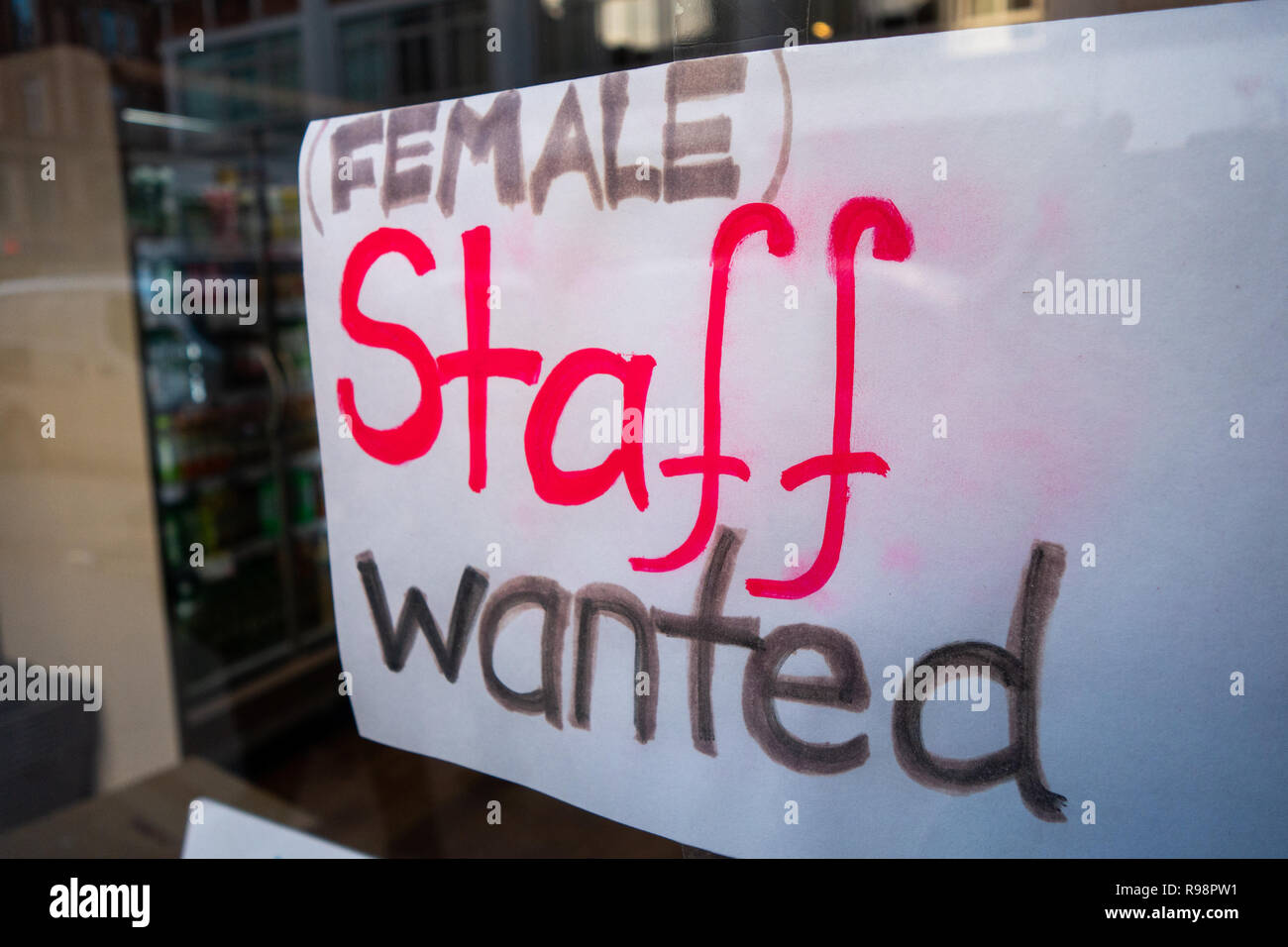Female Staff Hand written wanted sign. in a cafe on Tottenham Court Rd, Bloomsbury, London W1, England - Stock Image
