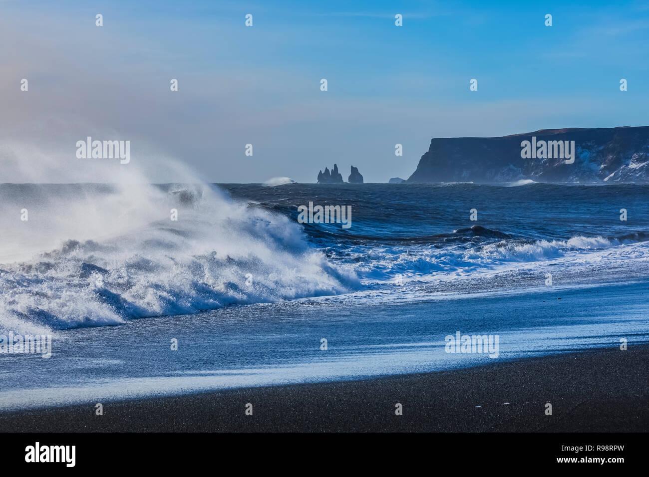 Powerful waves crashing along the Reynisfjara Beach, a black sand beach near the village of Vik, in winter in Iceland Stock Photo