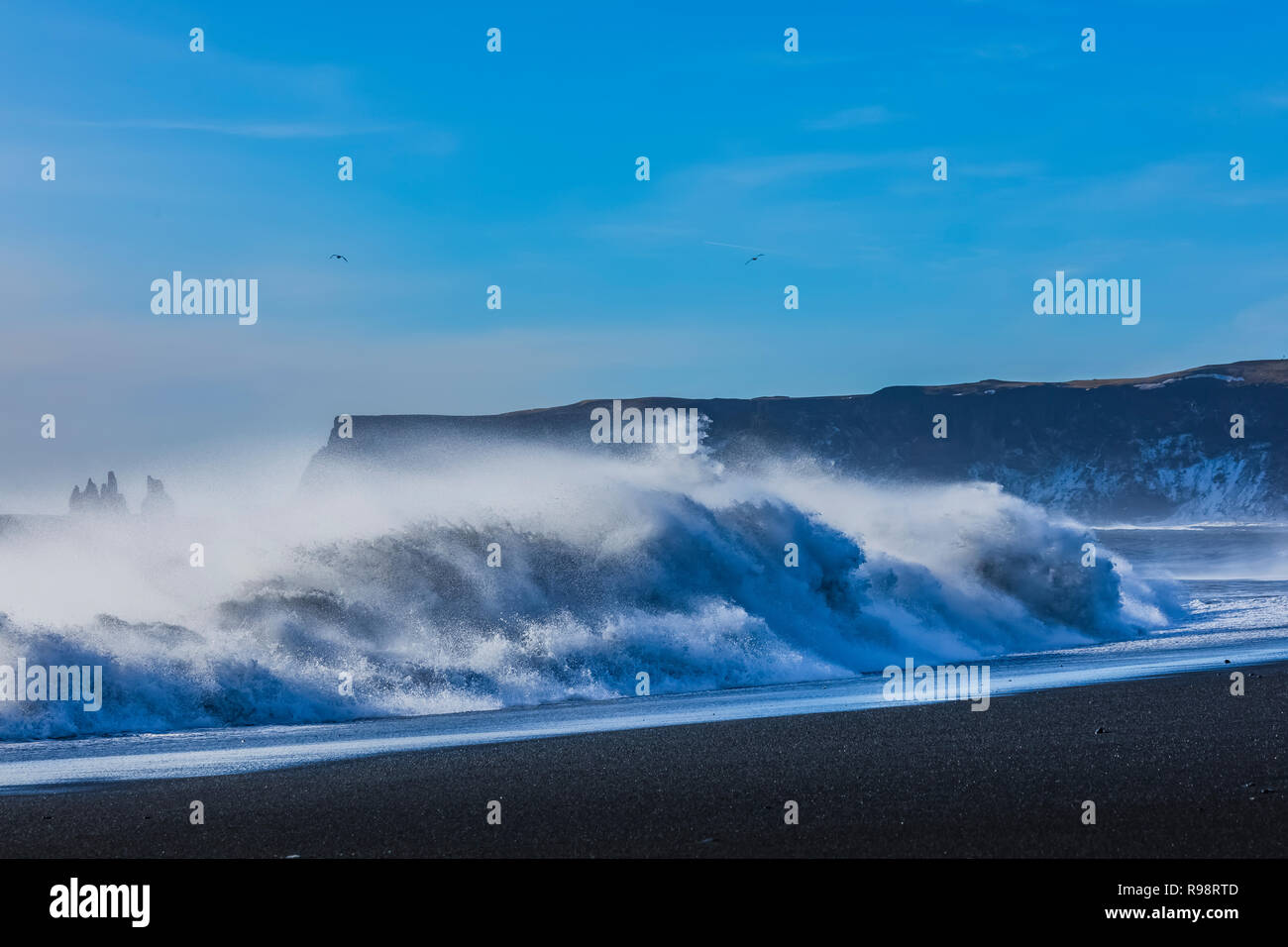 Powerful waves crashing along the Reynisfjara Beach, a black sand beach near the village of Vik, in winter in Iceland Stock Photo
