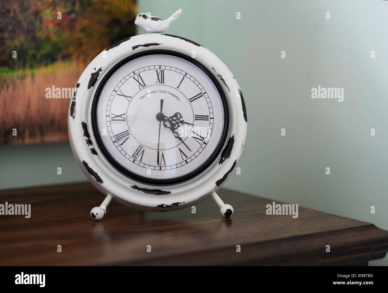 A new clock made to look old in the Modern Farmhouse style and decor. USA. - Stock Image
