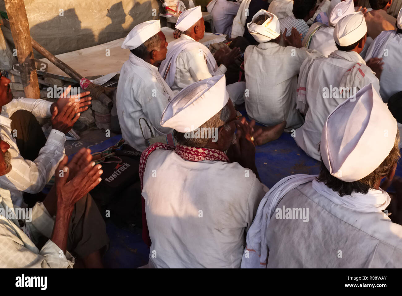 Impoverished farmers from Maharashtra state attending a political rally at Azad Maidan, Mumbai, India, a popular rallying point in Mumbai - Stock Image