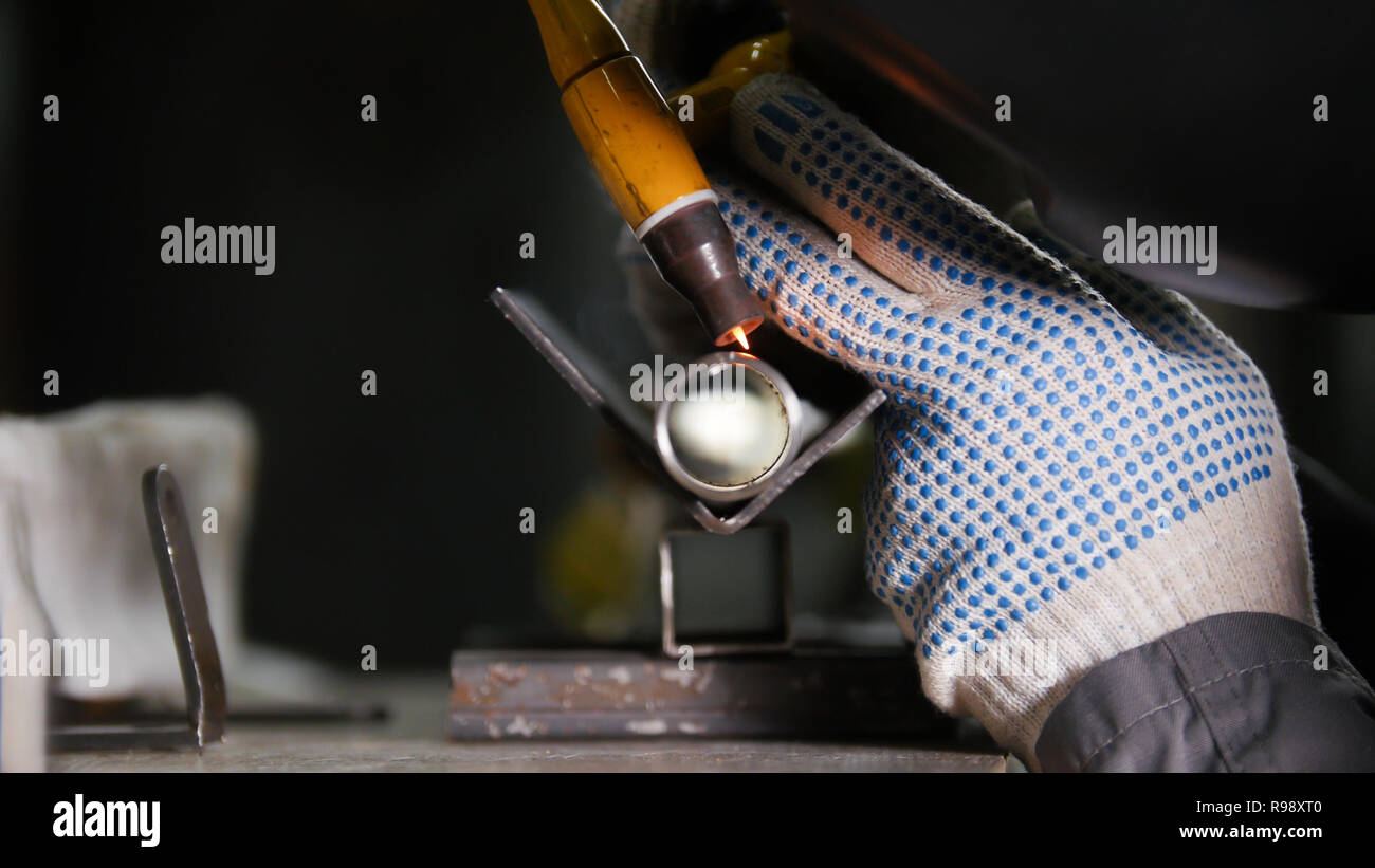 Industrial manufacturing. An iron tube detail. Welding process. rigorous work Stock Photo