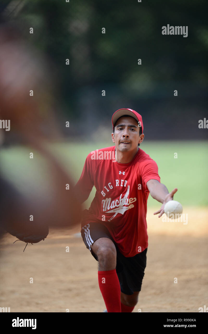 Softball players in Central Park in New York City Stock Photo