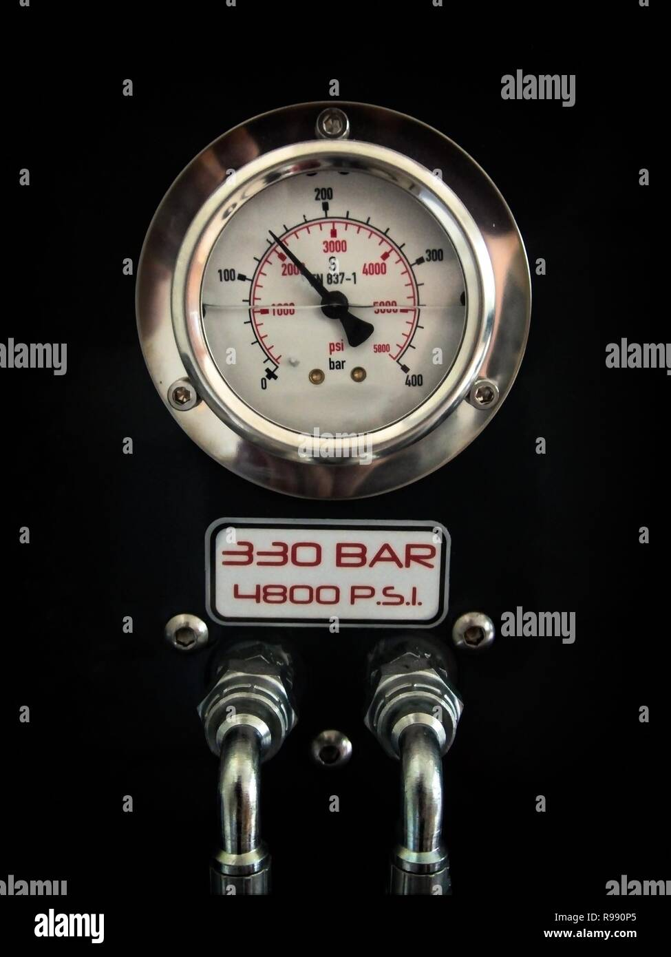 Analogous chromed gauge with pressure pipes in scuba tank compressor. - Stock Image