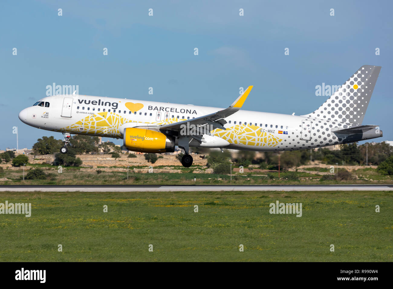 Vueling Airlines Airbus A320-232 (Reg: EC-MNZ) with special livery landing runway 31. - Stock Image